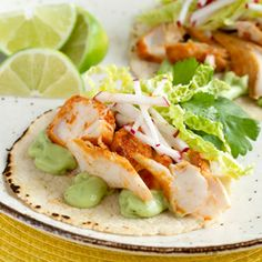 These Spicy Fish Tacos pair pan-fried chipotle-lime whitefish with a creamy avocado-yogurt sauce