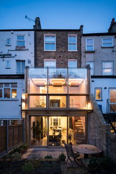 The architect chose to frame this conservatory-style extension in oak, a material that matches the warm tones of the building's original brickwork. In between the wooden beams, large panels of glass allow plenty of light to penetrate the interior. Victorian Townhouse, London Townhouse, London House, Victorian Terrace, Victorian Homes, Oak Framed Extensions, House Extensions, Townhouse Exterior, New Staircase