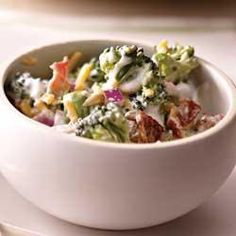 Creamy Bacon and Broccoli Salad.....I would add golden raisins, sugar & Miracle Whip to this like they do at Walmart............. Allrecipes.com