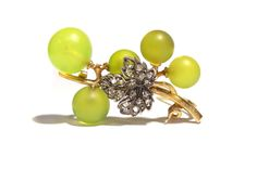 A jewelled and gold vine brooch by Fonseque et Olive    the naturalistically chased yellow gold stem mounted with a rose diamond  set vine leaf and five green glass grapes.    Georges Fonseque and Emile Olive made a specialty of these brooches in the form of grapes.  They were originally supplied in miniature wooden wine cases.    For a similar brooch see Henri Vever's La Bijouterie Française au XIXe Siècle,  translated by Katherine Purcell, page 1024.    Paris, circa 1889