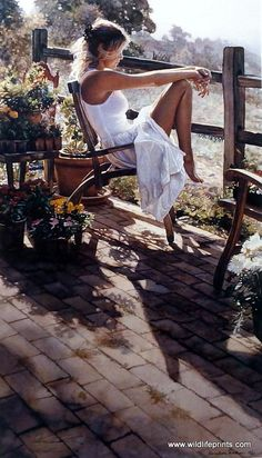 """A woman ponders on the patio surrounded by a beautiful garden and a wooden fence. This print is signed and numbered and is available unframed in size 16.5""""x28.5"""" A Donation Edition"""
