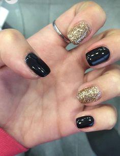 Semi permanente unghia nero e dorato glitterato
