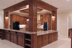 Designer Builders - Aiken SC - Custom Kitchens - stained wood cabinetry, granite counters, black appliances, raised bar, entertaining