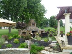 Outdoor stone fireplace and pergola