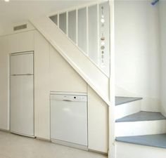 Use of under stair area for washer/dryer, refrigerator, pantry and storage.