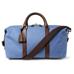 Stylish and sleek in the latest piece by Mulberry makes this a one of a kind bag. The light blue canvas with cream interior and brown accented handles are the perfect contrast for this look. Please al