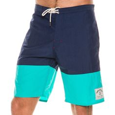 Iron and Resin Hemi boardshort.       Men's boardshorts.   Designed and custom made in California.       Retro inspired colorblock design.       Snap button fly with drawstring closure.       Button flap pocket at back right.       Custom brand label at left leg.       Outseam: 18 inches.       Cool machine wash, tumble dry low.       100% Polyester.       Made in the USA.       Vendor style #: IR0520SP16B2.         Size & Fit Guide      Model is wearing a Size: 32     Model's...
