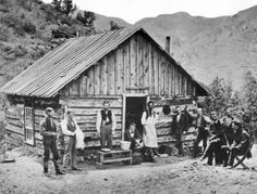 Exterior view of a square, gable roofed hewn log cabin in Manitou Springs, Colorado.  Circa 1870-1880.  The Library of Congress and The Denver Public Library Western History and Genealogy Department