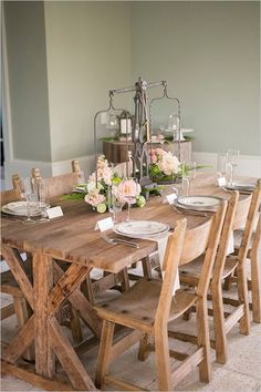 Rustic chic vintage tablescape - love the contrast of the soft flowers against the hard wooden table and chairs