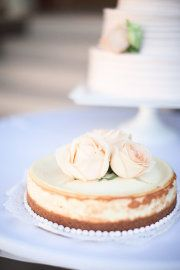 Your guys' own personal wedding cheesecake with pretty flowers on top.