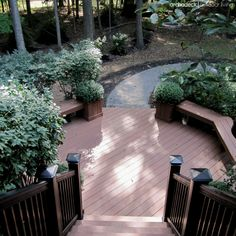 The lower platform of this multilevel, two-story deck blends seamlessly with the backyard garden and landscape.