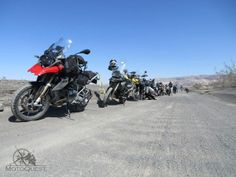 Bikes lined up. Death Valley. Wonders of the West Motorcycle Adventure with MotoQuest : https://www.motoquest.com/guided-motorcycle-tour.php?death-valley-43