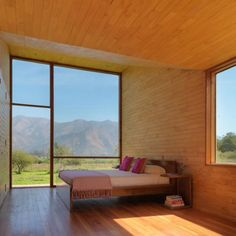 natural bedroom with the best picture window ever. sunset and sunrise heaven for sure.