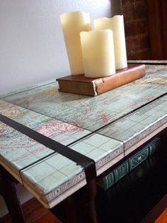 "This easy craft makes a ""world"" of difference! Use your favorite map (or a collage of a bunch of maps!) to refinish the top of an old table. group table --- DONE AND DONE! Crafts To Make, Home Crafts, Easy Crafts, Furniture Makeover, Diy Furniture, Repurposed Furniture, Map Projects, Cool Diy, Map Globe"