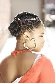 A dynamic twist to the classic bun. Cornrows really liven hair up - She's definitely turning heads!
