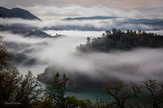 Fog lifts to reveal the lake below by SamuelNesbitt