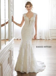 Lace slim A-line wedding dress with plunging neckline, lace sleeves and daring keyhole back, Melitta Marie by Maggie Sottero.