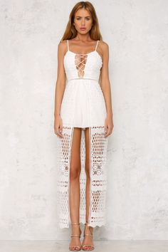 The Venice Canal Maxi Playsuit is sleeveless, with spaghetti straps, slightly padded bust cups, a laceup front and gorgeous lace detailing. The invisible back zip makes for easy wear! Style with heels and an embellished necklace! Maxi playsuit. Playsuit lining. Cold hand wash only. Model is standard XS and is wearing XS. True to size. Print may vary in placement. Non-stretchy fabric. Polyester.