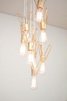 Retronaut Chandelier - 8 Bulb Rocket Lamp W/Edison Bulbs. $1,460.00, via Etsy.