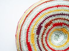 Striped round pillow in bright colors, croheted decorative cushion