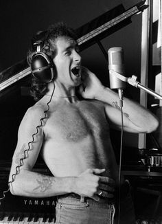 AC/DC: Four Decades of Big Riffs and Schoolboy Uniforms Pictures - AC/DC Timeline: 1975: Bon Scott in Recording Studio | Rolling Stone