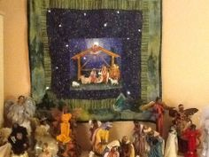Illuminated Nativity Panel over Christmas Mantel
