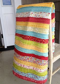 Awesome quilt...love the fraying of each fabric piece.