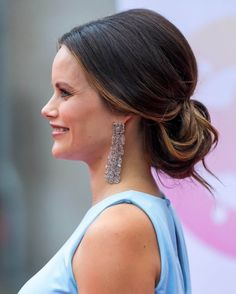 Princess Sofia of Sweden swept her glossy tresses into a low chignon making way for a pair of dazzling bejeweled earrings by Charlotte Bonde as she attended a charity party in the Swedish resort.
