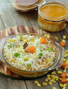 Layers of rice, cooked along with corn, carrot, capsicum and a few simple spices, interact with a richly-flavoured curry… and, the conversation between the layers in the corn pulao is rather interesting! baking the arrangement in an aluminium foil wrapper gives a special touch to the pulao.