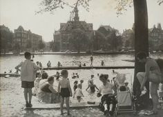 1957. Swimming on a hot summer day in the river Amstel near Weesperzijde in Amsterdam. #amsterdam #1950 #Amstel