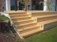 An example of steps cut in and then wrapping steps but I don. Landscaping Tools, Backyard Landscaping, Indoor Garden, Outdoor Gardens, Outdoor Farmhouse Table, Outdoor Spaces, Outdoor Living, Pergola, Modern Deck