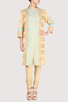 Golden suit enriched with puckered patterns on the sides. Shop Now: www.karmik.in/shopping/index.php