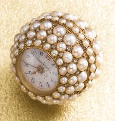 Tiffany & Co A YELLOW GOLD, DIAMOND AND PEARL-SET BALL-FORM PENDANT WATCH CIRCA 1890