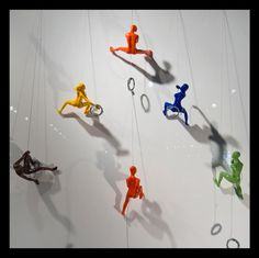 colored Climbing Man Wall Sculpture | ... interesting image with no less than 8 wall climbers. Very stimulating