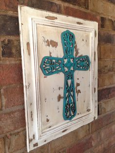 Salvaged Cabinet Door Upscaled With Turquoise Metal Cross
