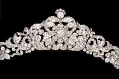 A diamond tiara, circa 1840 Designed as an articulated wreath of highly stylised blooms amongst meandering foliate motifs, set throughout with cushion-shaped, pear-shaped and old brilliant-cut diamonds, mounted in silver and gold, diamonds approximately 50.00 carats total, seven smaller diamonds deficient, detachable from frame and may be worn as a necklace, centrepiece may be detached and worn as a brooch