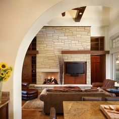 Asymmetrical but TV shares facade with fireplace.