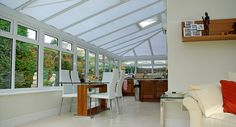 Our client had an existing timber conservatory which was poorly insulated and required considerable maintenance. The solution was to replace with a wrap round conservatory retaining the aesthetics of the former extension but being easier to maintain and more comfortable in the winter. To complete the project, we fully tiled the floor and carried out all decorations.