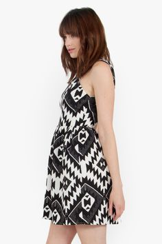 Make a statement in this Sugarlips Aztec Statement Dress, a black and white graphic printed fit and flare dress. Exposed zipper closure on back. Cutout at back. Fully lined. Pair it with a statement necklace and gladiator sandals to complete the look. #MyLuluCloset #Sugarlips #Storenvy #Dresses