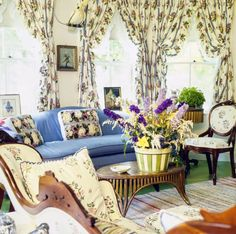 Classic Americana was Parish's (1910–1994) stock-in-trade. Her spaces combined an unpretentious, high-WASP sensibility with cheery details like chintz, needlepoint upholstery, and rag rugs. The living room of Parish's all-American vacation house, circa 1975, in Dark Harbor, Maine.