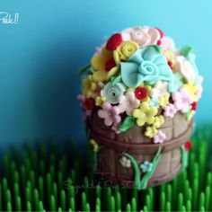 Basket of flowers Fondant Cake Topper for a Party Wagon event. Made by Sugar High, Inc.
