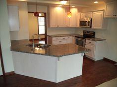 The Kitchen of a Hartford (14-47).   Granite Countertops and white kitchen cabinets