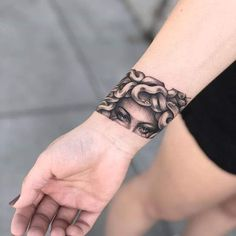 25 Medusa Tattoo Design Ideas with Meaning - medusa wrist band tattoo - Hot Tattoos, Mini Tattoos, Trendy Tattoos, Body Art Tattoos, Small Tattoos, Sleeve Tattoos, Tattoos For Guys, Tattoo Art, How To Do Tattoos