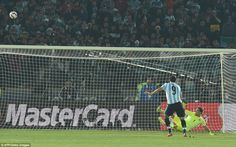 Gonzalo Higuain balloons his spot kick wildly over the bar to hand the initiative to the h...