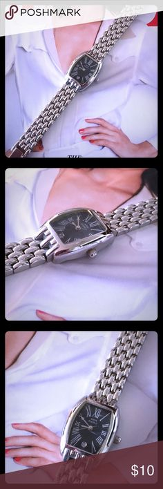 Classically Chic Anne Klein Silver Watch Previously Loved, and Well-Worn, this Anne Klein Silver Chain Link Watch Remains a Classically Chic-Looking Addition to Any Jewelry Collection; Stainless Steel Back; Black Watch Face with Roman Numerals; Watch Needs Battery Replaced; Date Function on Face (Not sure if accurately keeps the date with battery or not.) Has a Number of Surface Scratches as Well as Other Signs of Tarnish and Wear; Slight Cloudiness to Face; No Box or Links; Fits a Small…