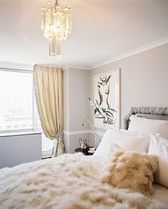 Grey and white bedroom with a fabulous light fitting