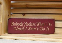"""This wooden sign is made from pine, and measures Approx 4.5"""" H x 13"""" W. It reads """"Nobody Notices What I Do Until I Don't Do It. The front is painted Barn Red then distressed, the back is stained . The"""