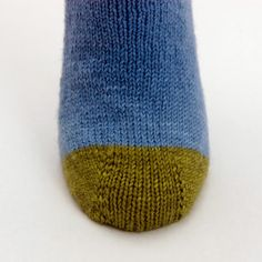 Math4Knitters: Dyad Socks - I wanted to explore the easiest way I know to make a two-color sock: one color for the heel and toe, and another for the rest of the sock. I was also eager to use a band heel and a toe to match.  In Sock Architecture, they are worked both from the top down and the toe up in five sizes, plus a plug-in-your numbers size.