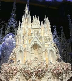 amazing wedding cakes This elaborate and intricate wedding cake looks as if it has been inspired by a cathedral, perhaps Notre Dame in Paris, and features several adorable cherubs as well as delicate spires, all made out of fondant icing and sugar flowers Castle Wedding Cake, Crazy Wedding Cakes, Crazy Cakes, Beautiful Wedding Cakes, Gorgeous Cakes, Fancy Cakes, Pretty Cakes, Amazing Cakes, Disney Wedding Cakes