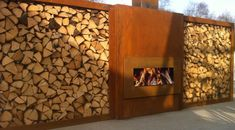 Made with steel. Backyard Fences, Garden Landscaping, Yard Privacy, Firewood Storage, Backyard Lighting, Corten Steel, House Inside, Outdoor Entertaining, Growing Vegetables